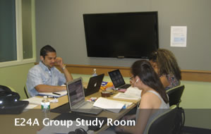 A group of students studying in the E24A Study Room