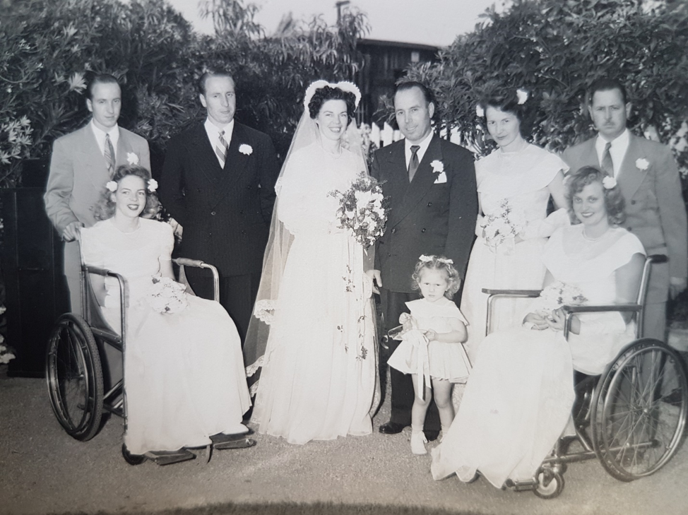 Wedding photo with 2 women in wheelchairs