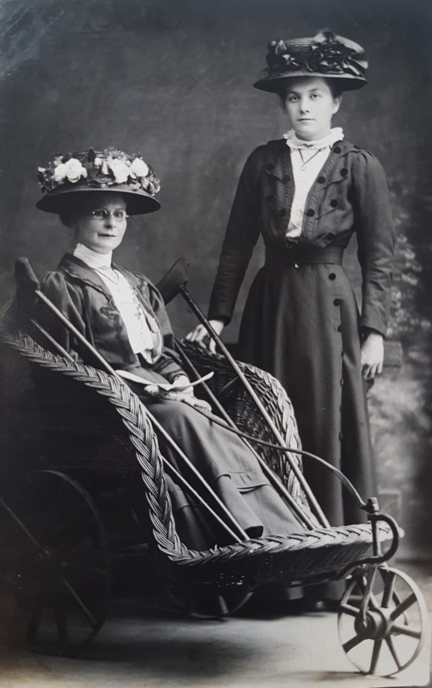 Woman with another woman in a wheelchair