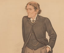 Image of a man standing up with his hands in his pockets.