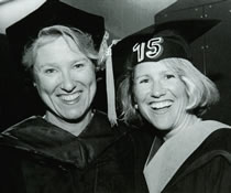 Image of two graduates from the Yale School of Nursing.
